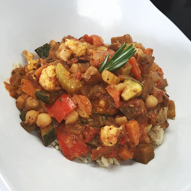 Main dish of the day: chickpea ratatouille with roasted eggplant, zucchini, cauliflower, sundries tomatoes, bell peppers and carrots simmered in a herbed tomato broth served over brown rice  fuel your body with wholesome delicious plant based food #glutenfree #vegan #soyfree #wheatfree #wholegrain #onthego #healthy