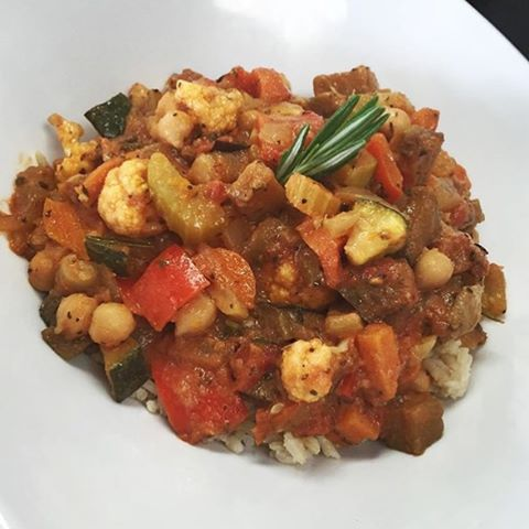 Chickpea ratatouille with fennel, eggplant, sweet potatoes, bell peppers and zucchini simmered in a tomato herbed broth served over brown rice #glutenfree #vegan #soyfree #wheatfree #wholegrain #plantbased #plantprotein #hearthealthyfood