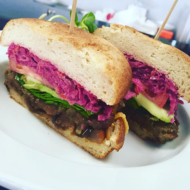 It's that ELMWICH time, our signature sandwich with caramelized onions, eggplant bacon, spinach, tomato, cheddar cheese, avocado and house coleslaw #glutenfree #vegan