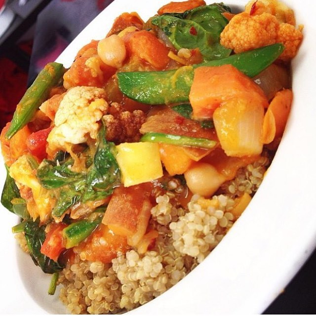 Thai red curry with roasted cauliflower, root vegetables, snow peas and mangoes simmered in an almond coconut Thai curry broth served over quinoa #glutenfree #vegan #wheatfree #wholegrain #cleaneating