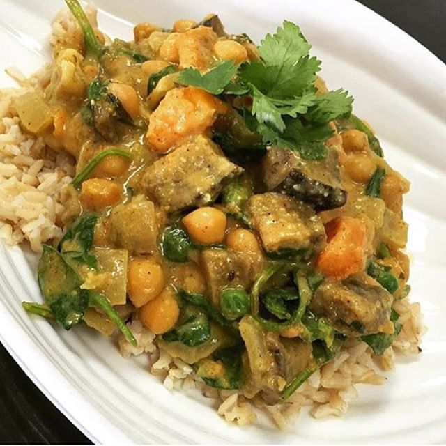 South Indian chickpea curry with greens peas, roasted squash, cauliflower, spinach and eggplant simmered in an almond coconut broth served over quinoa or brown rice #glutenfree #vegan #soy #dairyfree #southindiancurry #mtl