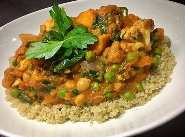 North Indian chickpea curry with green peas, cauliflower, spinach, sweet potatoes, carrots and eggplant simmered in a tomato almond broth served over quinoa #glutenfree #vegan #dairyfree #plantbased #plantstrong #plantprotein #cleaneating