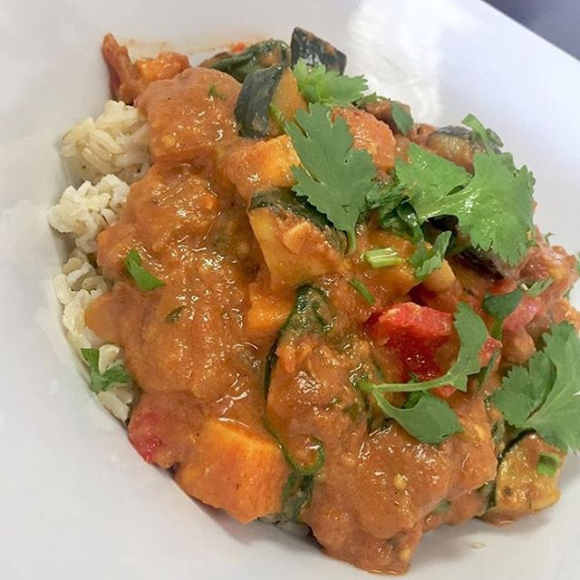 Hearty Moroccan stew with apricots, eggplant, cauliflower, bell peppers, squash and tomatoes simmered in a spiced tahini broth #glutenfree #vegan #dairyfree #mealstogo #soyfree #cleanliving #crueltyfree