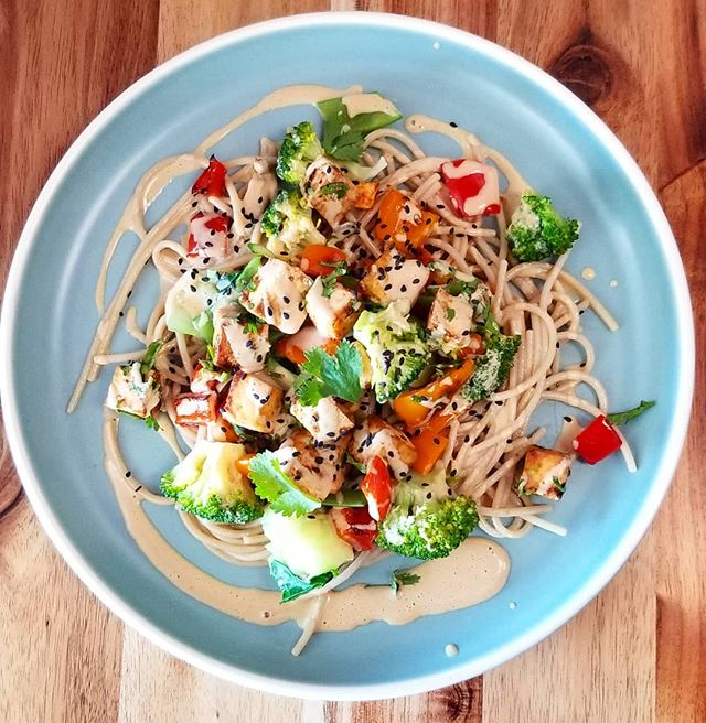 Tofu saute with brown rice noodles, bok choy, snow peas, broccoli and bell peppers covered with an almond butter sauce #glutenfree #vegandishes #vegan #vegansofinstagram #plantbaseddiet #plantbasedgoodness #plantbasedgourmet